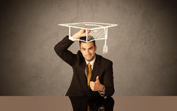 Happy college graduate drawing academic hat Stock Photos