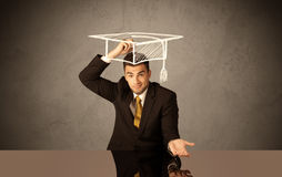 Happy college graduate drawing academic hat Royalty Free Stock Image