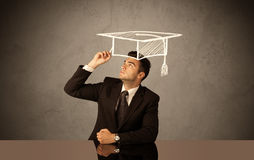 Happy college graduate drawing academic hat Stock Image