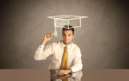 Happy college graduate drawing academic hat Royalty Free Stock Images