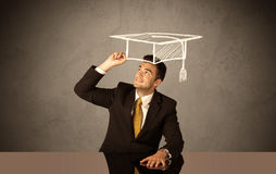 Happy college graduate drawing academic hat Stock Photo