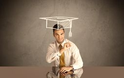 Happy college graduate drawing academic hat Royalty Free Stock Photos