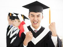 College graduate at graduation with classmates Royalty Free Stock Photos