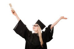 Happy college graduate wearing cap and gown holding diploma Stock Images