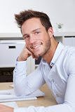 Happy college student at desk Royalty Free Stock Photo