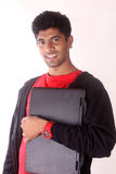 Happy college student holding laptop. Royalty Free Stock Photo