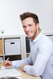 Happy college student learning at Royalty Free Stock Photo