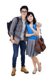 Happy college students with bags and books Royalty Free Stock Photo