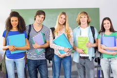 Happy college students holding folders Royalty Free Stock Photo