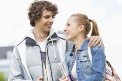 Happy college students looking at each other at campus Royalty Free Stock Image