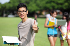Happy College students. Happy College student men smile and show thumb up to you on campus lawn, asian Stock Photography