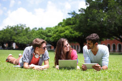 Happy College students using computer Stock Photo