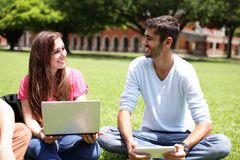 Happy College students using computer Stock Images