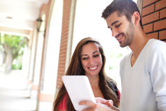 Happy College students using computer Royalty Free Stock Photo