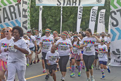 Happy Color Run Racers Start Running Stock Image