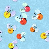 Happy colored bees seamless pattern on blue background Royalty Free Stock Images