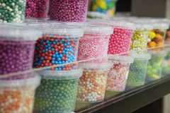 Happy colorful candies at the shop. Lot of boxes of different kinds of candies in the shop Royalty Free Stock Image
