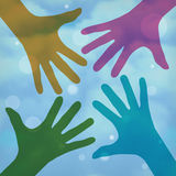 Happy colorful hands on a cloudy background Royalty Free Stock Images