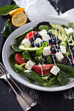 Happy and colorful salad. With greens, vegetables, feta cheese stock image