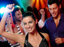 Happy companionship on dance floor. Happy young companionship having fun on dance floor Stock Images