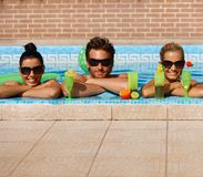 Happy companionship in swimming pool Stock Photo