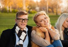 Happy company in autumn park Royalty Free Stock Photos