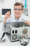 Happy  computer engineer working on broken device Royalty Free Stock Image