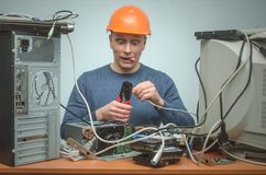 Computer repairman. Computer technician engineer. Support service. Happy Computer network technician is crimping a network cable by crimper tool in his hands stock image