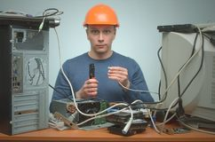 Computer repairman. Computer technician engineer. Support service. Happy Computer network technician is crimping a network cable by crimper tool in his hands stock images