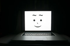 Happy computer saved from cyber criminals Royalty Free Stock Images