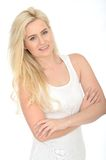Happy Confident Attractive Young Woman Standing With Her Arms Folded Royalty Free Stock Photo