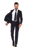 Happy confident business man walking with flying open jacket. On white background Stock Photos