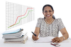 Happy and confident Business Woman with a Financial growth curve Royalty Free Stock Images