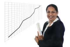 Happy and confident Business Woman showing a Financial growth curve Royalty Free Stock Image