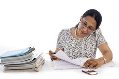 Happy and confident Business Woman at Work in her office Royalty Free Stock Images
