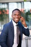 Happy confident businessman calling by cell phone. Close up portrait of a happy confident businessman calling by cell phone Stock Photo
