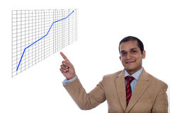 Happy and confident Businessman explaining the growth curve Royalty Free Stock Photo