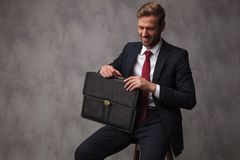 Happy confident businessman holding briefcase is ready for his i royalty free stock images
