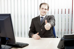 Confident businessman giving a thumbs up Royalty Free Stock Photos