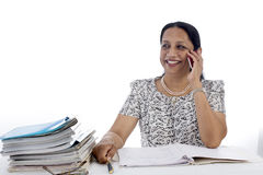 Happy and confident Businesswoman at Work talking on phone Stock Photo