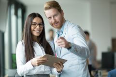 Happy and confident colleagues looking for you. At expanding company Royalty Free Stock Image