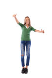 Happy confident girl showing thumbs up gesture over white backgr Stock Photography