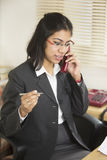 Happy and Confident Indian Businesswoman talking on Telephone. Royalty Free Stock Photography