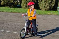 Happy confident little boy on his bike Stock Image
