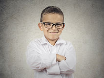 Happy confident little boy, small man. Closeup portrait standing, smiling little Boy, happy young man with hands folded, isolated grey, black background copy Stock Photos