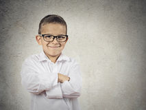 Happy confident little boy, small man. Closeup portrait standing, smiling little Boy, happy young man with hands folded, isolated grey, black background copy royalty free stock photography