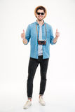 Happy confident man with old vintage camera showing thumbs up Royalty Free Stock Photos