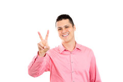 Happy confident man showing peace or victory sign Royalty Free Stock Photos