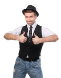 Happy confident man with thumbs up gesture Stock Photography