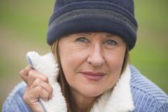 Happy confident mature woman jacket and bonnet Stock Photography